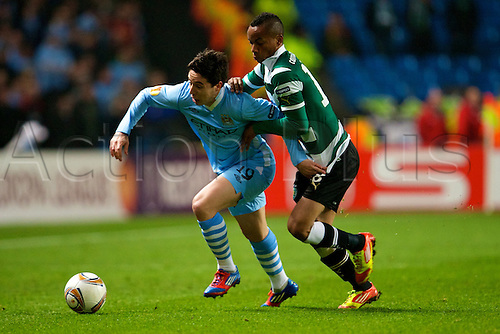 15.03.2012 Manchester, England. Manchester City's French midfielder Samir Nasri and sport Peruvian forward André Carrillo in action during the UEFA Europa Cup match between Manchester City v Sporting at the Etihad Stadium. City won the game 3-2 on the night but lost out to away goals on aggregate and crashed out of the tournament.