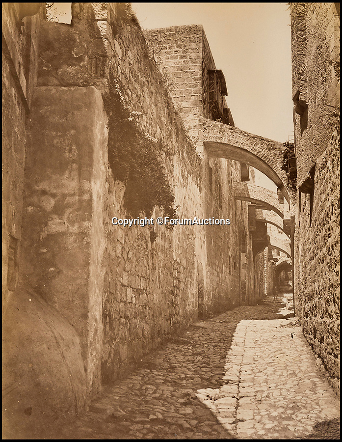 BNPS.co.uk (01202 558833)Pic: ForumAuctions/BNPS<br /> <br /> Part of the Via Dolorosa - the path taken by Christ on the route to his crucifixion.<br /> <br /> Palestine 1870-80's.<br /> <br /> Captivating early photos of Palestine have come to light 140 years later which provide a fascinating glimpse into life in the Holy Land.<br /> <br /> French photographer Levant Bonfils' snaps of Palestine from the 1870s and 1880s include views of Jerusalem, the road to Bethlehem and Jaffa Port.<br /> <br /> It was a pivotal time in the history of Palestine which was experiencing a major influx of Jewish settlers fleeing persecution in Eastern Europe.