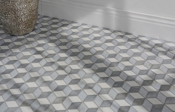 Euclid Grand, a hand-cut mosaic shown in polished Dolomite, polished Celeste, and honed Allure, is part of the Illusions® collection by New Ravenna.