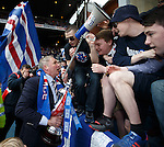 Ally McCoist with the SFL Division 3 trophy and talking to the UB and TBO fans on their megaphone