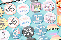 Campaign buttons for sale hang on a seller's board before Elizabeth Warren's speech announcing her candidacy for the 2020 presidential election at Everett Mills, site of the 1912 Bread and Roses strike, in Lawrence, Massachusetts, USA, on Sat., Feb. 9, 2019. The buttons feature messages of protest and resistance and include images of Elizabeth Warren, Frida Kahlo, Ruth Bader Ginsburg, Donald J. Trump, Alexandria Ocasio-Cortez, and mentions of Black Lives Matter, the 2016 Women's March, impeachment, and Robert S. Mueller's investigation.