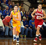 BROOKINGS, SD - MARCH 30:  Steph Paluch #15 from South Dakota State University pushes the ball past Alexis Gassion #23 from Indiana University in the second half of their WNIT quarterfinal game Sunday afternoon at Frost Arena in Brookings. (Photo by Dave Eggen/Inertia)
