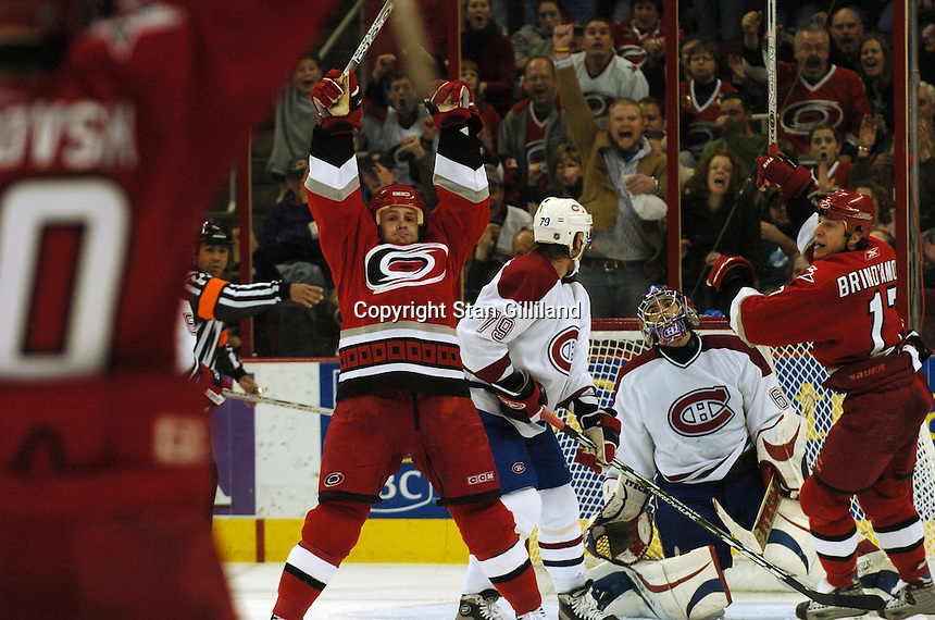 Montreal Canadiens' goaltender Jose Theodore and teammate Andrei Markov (79) of Russia watch as the Carolina Hurricanes' Cory Stillman, center, and Rod Brind'Amour, far right, celebrate Stillman's goal during their game Saturday, Dec. 31, 2005 in Raleigh, NC. Carolina won 5-3.