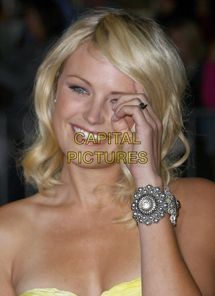 """MALIN AKERMAN.""""Couples Retreat"""" Los Angeles Premiere held at Mann Village Theatre, Westwood, CA, USA..October 5th, 2009.headshot portrait strapless yellow top ackerman hand silver bracelet cuff .CAP/ADM/CH.©Charles Harris/AdMedia/Capital Pictures"""