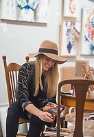 NWA Democrat-Gazette/BEN GOFF @NWABENGOFF<br /> Amy Eichler works on a painting Thursday, Nov. 8, 2018, while exhibiting at Hark &amp; Herald Collaborative Space during the 'Light Up the Night!' one year anniversary Art on the Bricks art walk in downtown Rogers. More than 25 artists and musicians opened pop-up galleries selling their artwork at downtown shops and restaurants. Go Downtown Rogers hosts the walks on the second Thursday of each month.