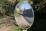 Convex mirror used for road view, Shottisham, Suffolk, England, UK