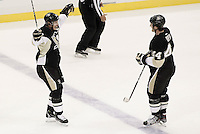 PITTSBURGH, PA - NOVEMBER 21:  Sidney Crosby #87 of the Pittsburgh Penguins celebrates his assist on teammate Brooks Orpik #44 goal in the first period against the New York Islanders during the game on November 21, 2011 at CONSOL Energy Center in Pittsburgh, Pennsylvania. Crosby hasn't played since January 5th after sustaining a concussion.  (Photo by Jared Wickerham/Getty Images)