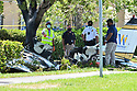 MIRAMAR, FL - MAY 12: Investigator wearing mask on they faces look over the crash site of a Piper PA-34 plane on May 12, 2020 in Miramar, Florida. The plane was seen flying low over an intersection before clipping a power line and crashing, killing the pilot, identified as 25-year-old Mark Daniel Scott, and leaving the flight instructor seriously injured. A third person on the ground was injured by debris.   ( Photo by Johnny Louis / jlnphotography.com )