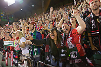 Portland, Oregon - Sunday September 11, 2016: Thorns supporters cheer during a regular season National Women's Soccer League (NWSL) match at Providence Park.