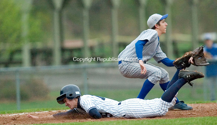 WASHINGTON DEPOT, CT- 02 MAY 2008- 050208JT04-<br /> Shepaug's Ben Carlson steals third base as he slides past Lewis Mills' Spencer Mauro during Friday's game at Ted Alex Field.<br /> Josalee Thrift / Republican-American