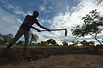 Latigo Richard, 15, prepares the soil for planting in the Rhino Refugee Camp in northern Uganda. As of April 2017, the camp held almost 87,000 refugees from South Sudan, and more people were arriving daily. About 1.8 million people have fled South Sudan since civil war broke out there at the end of 2013. About 900,000 have sought refuge in Uganda.