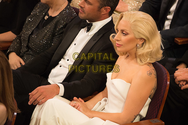 Taylor Kinney and Oscar&reg;-nominee Lady Gaga attend The 88th Oscars&reg; at the Dolby&reg; Theatre in Hollywood, CA on Sunday, February 28, 2016.<br /> *Editorial Use Only*<br /> CAP/PLF<br /> Supplied by Capital Pictures