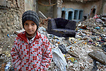 A girl stands amid the rubble of what were once homes in the old city of Mosul, Iraq. This portion of the city was heavily damaged in 2016 and 2017 when Iraqi forces, supported by U.S. air strikes, combated Islamic State fighters who held residents of the old city as human shields.