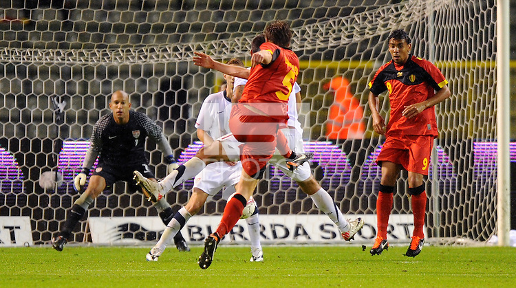 Belgium's Nicolas Lombaerts (C) scores 1:0 against US goalkeeper Tim Howard during the friendly match Belgium vs USA at King Baudoin stadium in Brussels, Belgium on September 06th, 2011.