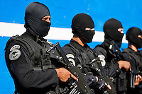 Salvadorean policemen, members of the specialized anti-gang unit (Unidad Antipandillas), stand on the police base before leaving for an operation in San Salvador, El Salvador, 19 December 2013. The anti-gang force, comprising of 300 officers, is part of a new security policy, launched by the government with a goal to fight directly the major street gangs (Mara Salvatrucha and 18th Street Gang) and reduce the high level of violence in the country, caused mainly by the gang criminal activities.