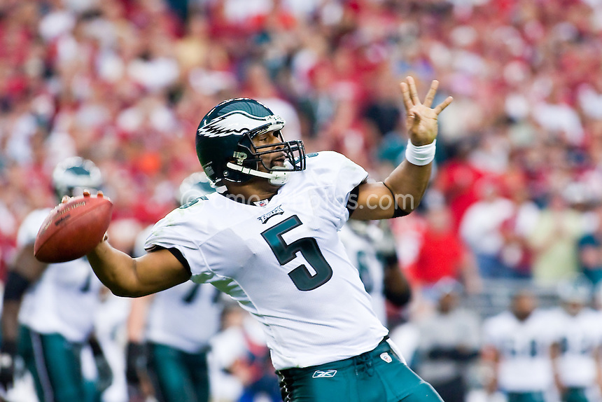 Jan 18, 2009; Glendale, AZ, USA; Philadelphia Eagles quarterback Donovan McNabb (5) throws a 62-yard touchdown pass in the fourth quarter of the NFC Championship Game against the Arizona Cardinals at University of Phoenix Stadium.  The Cardinals won the game 32-25 to advance to Super Bowl XLIII.