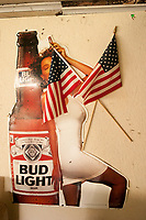 Beer, babe and the American Flag on the wall of a dilapidated juke joint in East Texas. (2008)