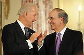 Washington, DC - January 22, 2009 -- United States Vice President Joseph Biden (L) applauds former Senator George Mitchell during an event where Mitchell was announced as special envoy to the Middle East, at the State Department  in Washington, DC, USA on 22 January 2009. Former Ambassador Richard Holbrook will serve as envoy Pakistan and India..Credit: Matthew Cavanaugh - Pool via CNP