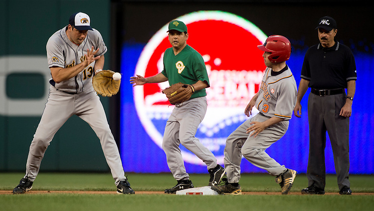 UNITED STATES - JUNE 25: Rep. Chuck Fleischmann, R-Tenn., right, steals second base as Short stop Rep. Tim Ryan, D-Ohio, left, and second baseman Rep. Raul Ruiz, D_calif., defend during the Roll Call Congressional Baseball Game on Wednesday, June 25, 2014. (Photo By Bill Clark/CQ Roll Call)