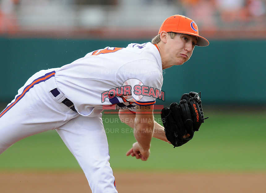 Byrnes High School product starting pitcher Daniel Gossett (23) of the Clemson Tigers pitches during a game against the William & Mary Tribe on Opening Day, Friday, February 15, 2013, at Doug Kingsmore Stadium in Clemson, South Carolina. Clemson won, 2-0. (Tom Priddy/Four Seam Images)