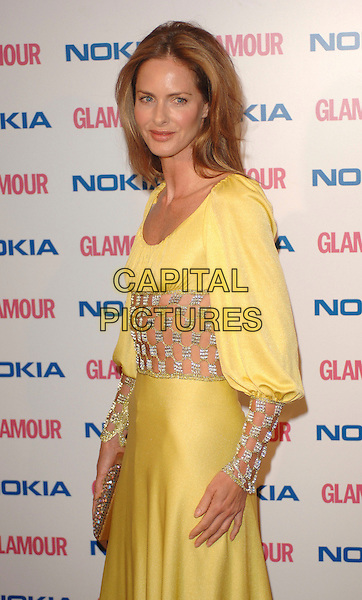 TRINNY WOODALL.The Glamour magazine 3rd Annual Women Of The Year Awards, Berkley Sqaure, London, England..June 6th, 2006.Ref: BEL.half length yellow satin dress diamante jewel see through thru sleeves cuff midriff.www.capitalpictures.com.sales@capitalpictures.com.© Capital Pictures.