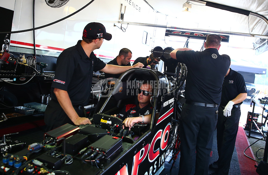 Jun. 2, 2013; Englishtown, NJ, USA: NHRA crew members for top fuel dragster driver Steve Torrence during the Summer Nationals at Raceway Park. Mandatory Credit: Mark J. Rebilas-
