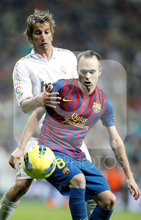 Barcelona's Andres Iniesta against Real Madrid's Fabio Coentrao during La Liga Match. December 11, 2011. (ALTERPHOTOS/Alvaro Hernandez)