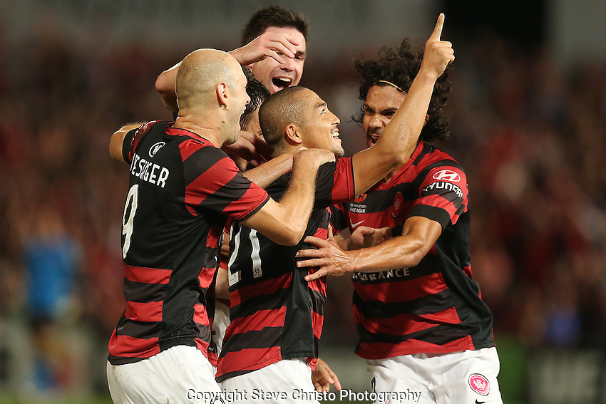 A-League semi final Western Sydney Wanderers FC v Brisbane Roar FC at Parramatta Stadium. Wanderers celebrate with Shinji Ono after his goal. Friday 12th April 2013. Photo: (Steve Christo)