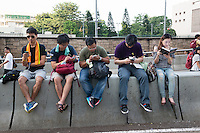 Hong Kong, Government Offices, 1 October 2014<br /> <br /> Students and other supporters of the Occupy Central movement congregating around the government offices area at Tamar. All the roads in the area are blocked from traffic and public transport.<br /> All on the smart phone except one who is reading 1984 by George Orwell.<br /> <br /> Photo Kees Metselaar