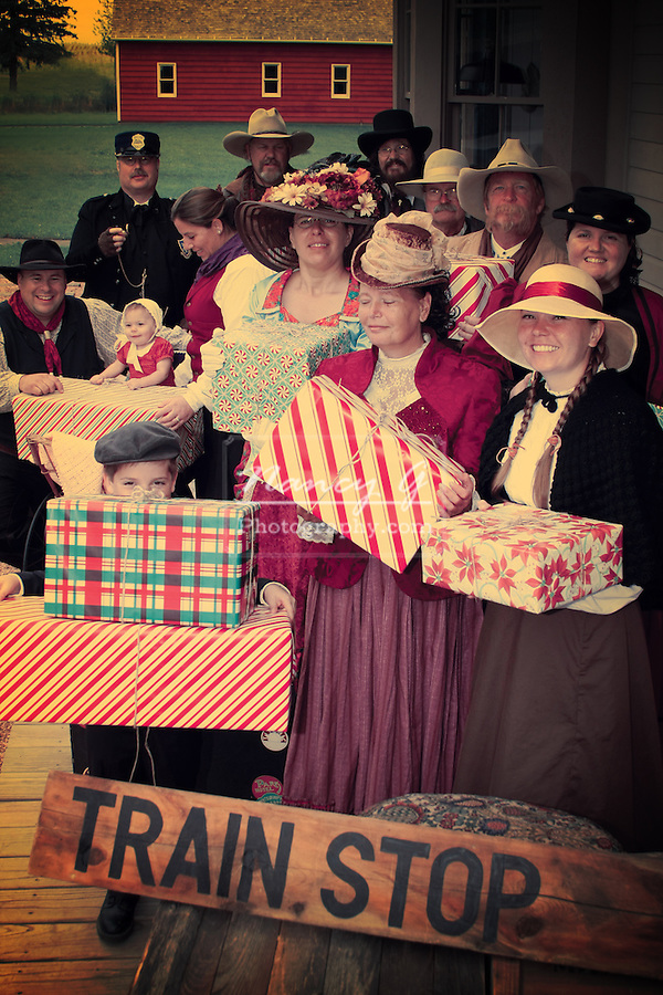Vintage of a group of old fashioned people waiting at the Train stop with Christmas presents