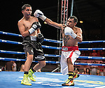 Oscar Vasquez, left, from Reno, Nevada fights Sergio  Lopez from Las Vegas, Nevada during the flyweight division of the Rural Rumble on Friday night, August 8, 2014 at Churchill County Fairgrounds in Fallon, Nevada.