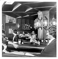 Bar in the Chateau Frontenac, photograph, 1960s, from the Archives of the Chateau Frontenac, Quebec City, Quebec, Canada. The Chateau Frontenac opened in 1893 and was designed by Bruce Price as a chateau style hotel for the Canadian Pacific Railway company or CPR. It was extended in 1924 by William Sutherland Maxwell. The building is now a hotel, the Fairmont Le Chateau Frontenac, and is listed as a National Historic Site of Canada. The Historic District of Old Quebec is listed as a UNESCO World Heritage Site. Copyright Archives Chateau Frontenac / Manuel Cohen