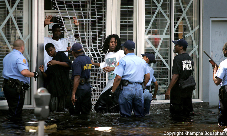 New Orleans police flush out looters on Canal Street on Tuesday, August 30, 2005.  Hurricane Katrina devasted the city days earlier.  (Fort Worth Star-Telegram/Khampha Bouaphanh)