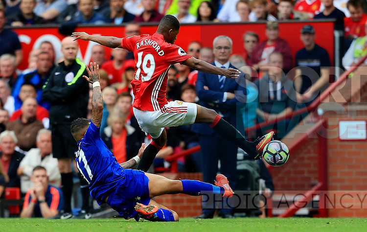 Danny Simpson of Leicester City tackles Marcus Rashford of Manchester United during the Premier League match at Old Trafford Stadium, Manchester. Picture date: September 24th, 2016. Pic Sportimage
