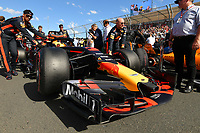 March 25, 2018: Mechanics wheel the car of Daniel Ricciardo (AUS) #3 from the Aston Martin Red Bull Racing team on the grid prior to the start of the 2018 Australian Formula One Grand Prix at Albert Park, Melbourne, Australia. Photo Sydney Low