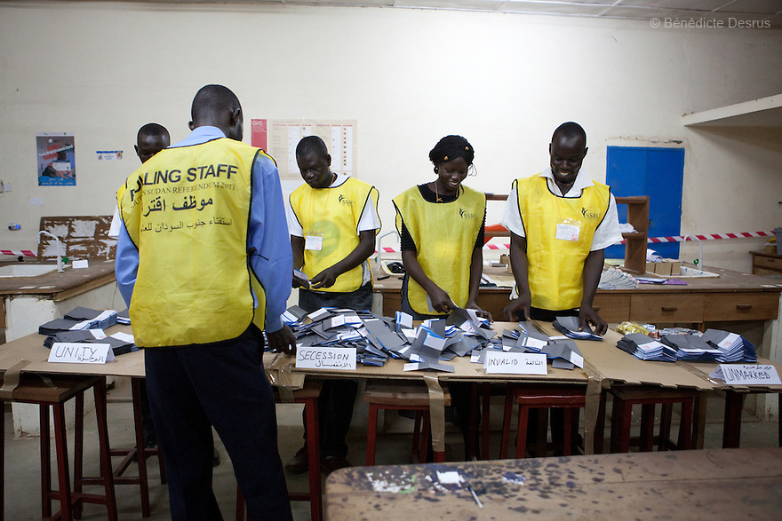 Poll workers count the votes after the closing of a polling station in Juba, South Sudan. South Sudan's polling centres closed their doors on Saturday after a week-long vote on independence from the north that could end a vicious cycle of civil war with the creation of the world's newest state. Photo credit: Benedicte Desrus