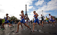 09 JUL 2011 - PARIS, FRA - Competitors head onto the run during the men's French Grand Prix series race in Paris, France. Amongst those pictured are Anton Tchutchko (Rouen Triathlon) (second from left) and Tom Bishop (Rouen Triathlon) (third from left) .(PHOTO (C) NIGEL FARROW)