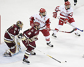 Tim Filangieri 5 of Boston College helps defend Cory Schneider's 1 of Boston College net from Jake Dowell 11 and Ben Street 22 of the University of Wisconsin. The Boston College Eagles defeated the University of Wisconsin Badgers 3-0 on Friday, October 27, 2006, at the Kohl Center in Madison, Wisconsin in their first meeting since the 2006 Frozen Four Final which Wisconsin won 2-1 to take the national championship.<br />