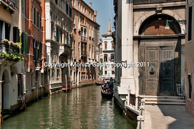 Gondolas making their way down a canal in Venice, Italy