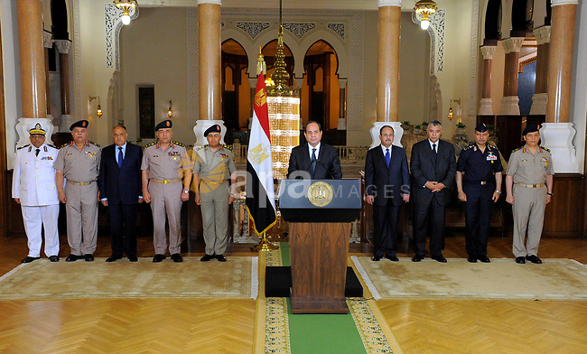 Egyptian President Abdel Fattah al-Sisi gives an address after the gunmen attack in Minya, accompanied by leaders of the Supreme Council of the Armed Forces and the Supreme Council for Police, at the Ittihadiya presidential palace in Cairo, Egypt, May 26, 2017. Photo by Egyptian President Office