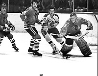 Seals vs Black Hawks: Ernie Hicke along with Hawks .Keith Magnuson, Bryan Campbell, and goalie Gerry Desjardins.  (photo 1970 by Ron Riesterer)