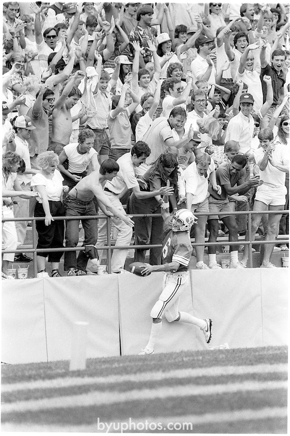 FTB 703 C 25<br /> <br /> BYU vs Tulsa. Quarterback 6 Robbie Bosco celebrates after scoring a touchdown.<br /> <br /> September 15, 1984<br /> <br /> Photo by Mark Philbrick/BYU<br /> <br /> &copy; BYU PHOTO 2009<br /> All Rights Reserved<br /> photo@byu.edu  (801)422-7322