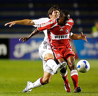 DC United defender Facundo Erpen (5) attempts to tackle the ball away from Chicago Fire midfielder Thiago (10).  The Chicago Fire defeated the DC United 3-0 in the semifinals of the U.S. Open Cup at Toyota Park in Bridgeview, IL on September 6, 2006...