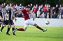 Linlithgow's Tommy Coyne could have had a hat trick but he puts the ball over the bar from yards out.