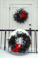 AJ5898, Christmas wreath, wreaths, decoration, ribbon, Christmas, holiday, snow, winter, Two snow covered green wreaths with red bows decorate the outside of a the Union Church for Christmas in Plymouth Notch in Windsor County in the state of Vermont.