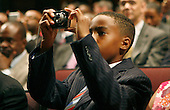 Albert Hicks IV takes a  picture of United States President Barack Obama making  a Father's Day speech at  THEARK in Washington, DC on Monday, June 21, 2010. .Credit: Dennis Brack - Pool via CNP