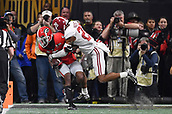 January 8th 2018, Atlanta, GA, USA; Alabama Crimson Tide defensive back Anthony Averett (28) tackles Georgia Bulldogs wide receiver Terry Godwin (5) during the College Football Playoff National Championship Game between the Alabama Crimson Tide and the Georgia Bulldogs on January 8, 2018 at Mercedes-Benz Stadium in Atlanta, GA.