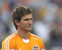 Houston Dynamo defender Bobby Boswell (32). In a Major League Soccer (MLS) match, Houston Dynamo (orange) defeated the New England Revolution (blue), 2-1, at Gillette Stadium on July 13, 2013.