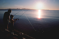 FATHER AND SON fishing off the sea wall of Loreto.Baja Sur