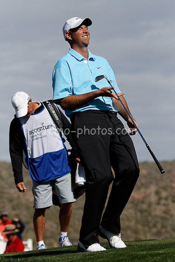Feb 24, 2008; Marana, AZ, USA; Stewart Cink reacts after narrowly missing a chip shot on the 13th hole during his final-round match against Tiger Woods (not pictured) at the Accenture Match Play Championship at the Gallery Golf Club. Woods would go on to beat Cink 8 and 7 to earn his third victory in the WGC match play event and 15th victory overall in the World Golf Championship series.